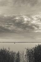 Juodkrantė · marios, nendrės, debesys 1694